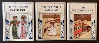 The Toyland Series (The First 3 Vols): The Unhappy Paper Doll, The Policeman Cat and The Dollville Railroad -- All in Dustjackets and Including the Publisher's Orginal Box